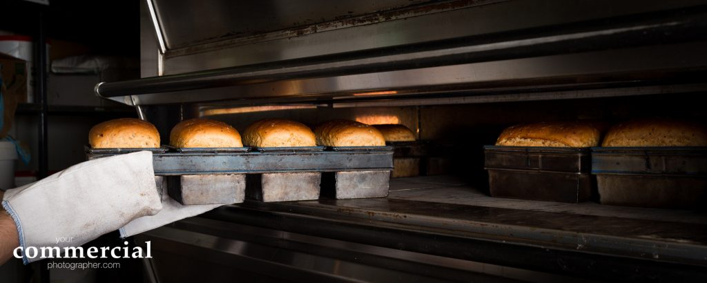 Food photography of bread coming from the oven at Sexton's Bakery, Lymm, Cheshire