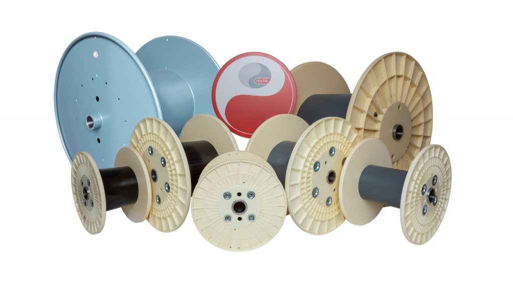 Cut out photo of cable reels on a white background.