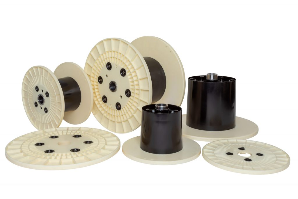 Cut out photo of cable reel components on a white background.