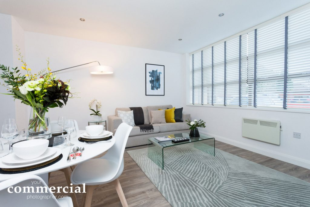 Interiors photograph of a living and dining area in a new apartment development in Wilmslow, Cheshire